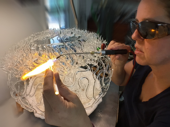 Torching glass coral sculpture